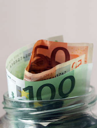Euro banknotes in glass bank Stock Photo - 2834930