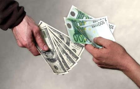 Two men exchange money. Giving money concept photo