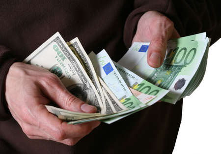 Man's hands hold Euro and dollars banknotes money Stock Photo - 2846065