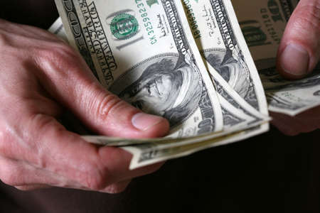 Man's hands hold dollars banknotes money Stock Photo - 2846068