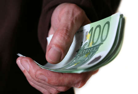 Hand giving Euro banknotes money Stock Photo - 2846057