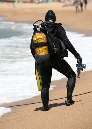 skindiver: Frogman with aqualungs on a coast of the mediterranean sea. Spain