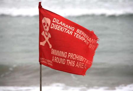 Swimming prohibited around this area flag in Kuta beach Bali photo