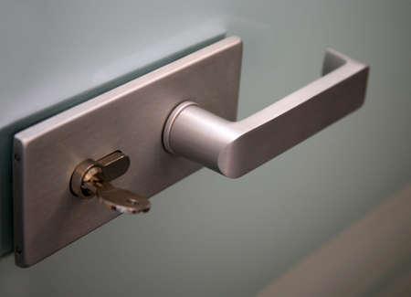 Metal door handle and the lock on a glass door Stock Photo - 3051908