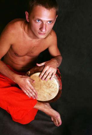 Man playing the nigerian drum in studio Stock Photo - 3083978