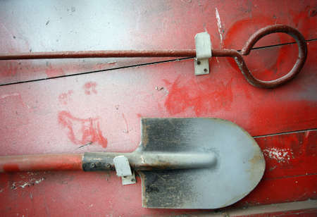 breakage: Shovel and breakage on a dusty red board Stock Photo
