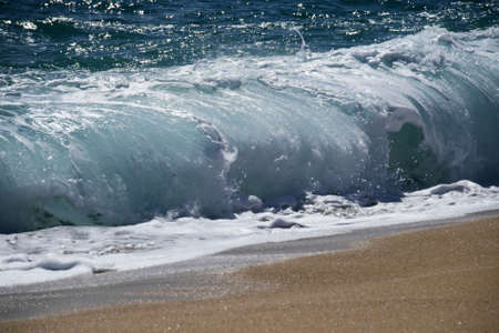 breaking wave: Blue coastal waves and sand