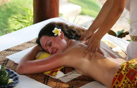 sensual massage: White woman on massage in Bali salon Stock Photo