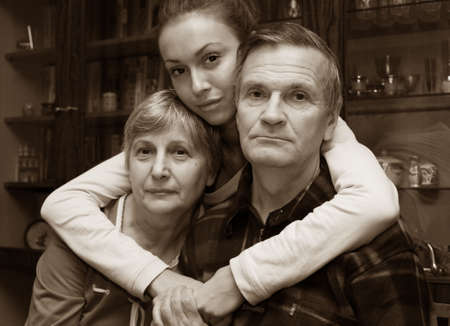 grand daughter: The grand daughter embraces the grandmother and the grandfather