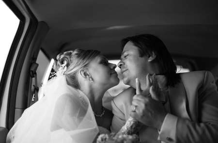 The bride with the groom in the automobile photo