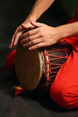 Man playing the nigerian drum in studio Stock Photo - 3240190