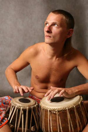 Man playing the nigerian drum in studio Stock Photo - 3255892