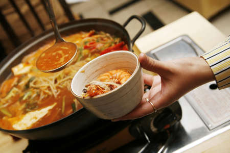 satisfying: Delightful healthy Asian kitchen - magnificent and nutritious Korean soup with noodles and seafoods