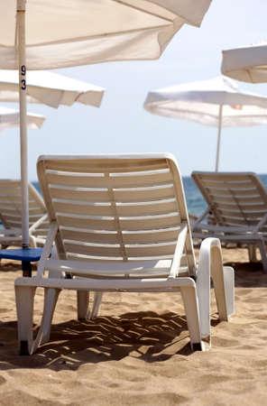 Deserted beach. Sun bed on a white beach  Stock Photo - 3357044