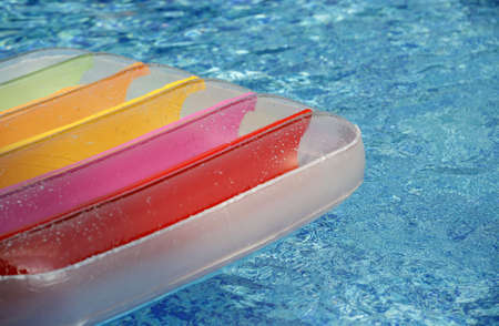 matress: a section of a air matress in pool