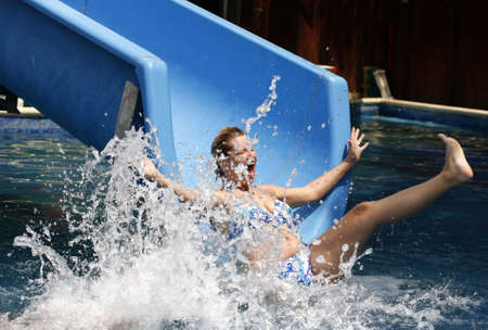 The adult woman rolls in a aquapark  Stock Photo