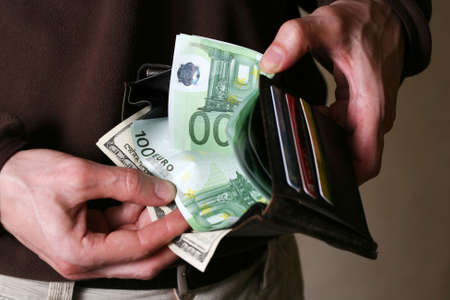 Man's hands with a purse close-up Stock Photo - 3409895