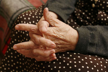 arthritic: Hands of the elderly woman close-up