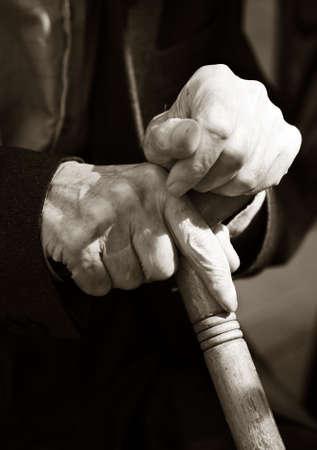 incapacitated: Hands of the elderly man. Bw+sepia