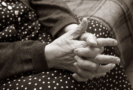 incapacitated: Hands of the elderly woman. Bw+sepia Stock Photo