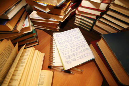 Many old books combined by a heap. Russian saying Knowledge - light, ignorance - darkness