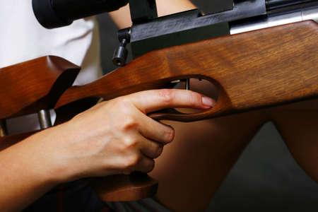 Female hand with a gun in studio photo