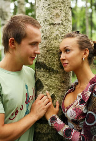 Young girl and the man in a forest Stock Photo - 3527878