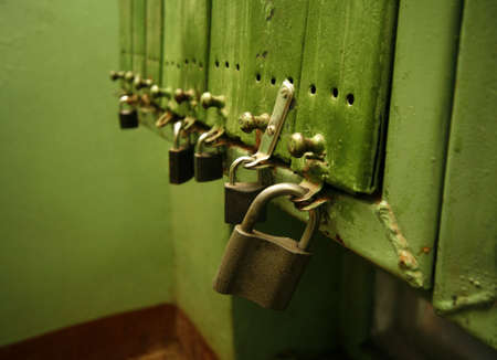 postmaster: Letter boxes with locks at the entrance of a building with apartments.