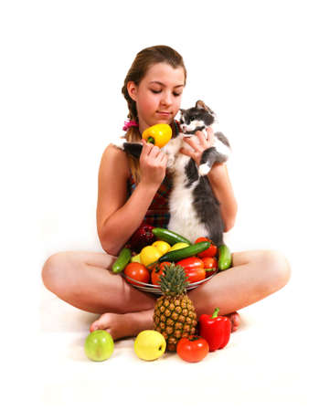 The girl with fruit and a cat on a white background Stock Photo - 3540454