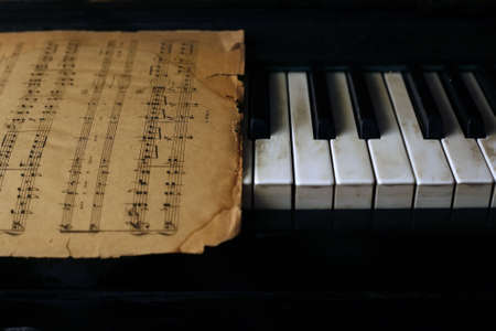The keyboard of the piano and old notes photo