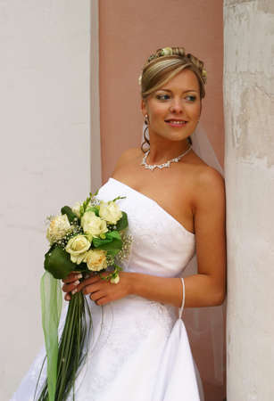 debutante: The beautiful bride with a bouquet from roses