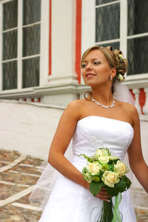 The beautiful bride with a bouquet from roses Stock Photo - 3644822