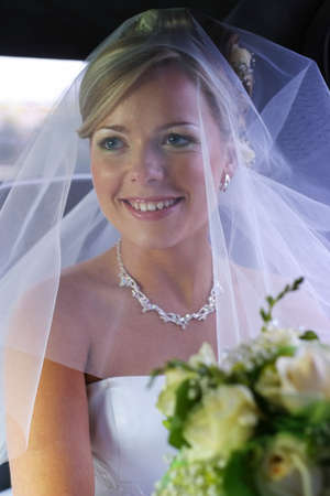 debutante: The beautiful bride is closed by a veil