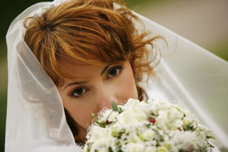 Portrait of the beautiful bride with a bouquet Stock Photo - 3654310
