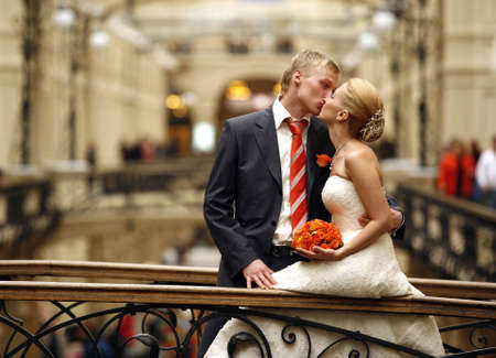 The beautiful bride and the groom in an interior Standard-Bild