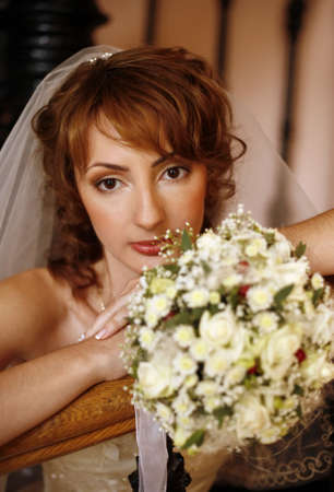 Portrait of the beautiful bride with a bouquet photo