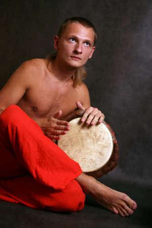 Man playing the nigerian drum in studio Stock Photo - 3654317