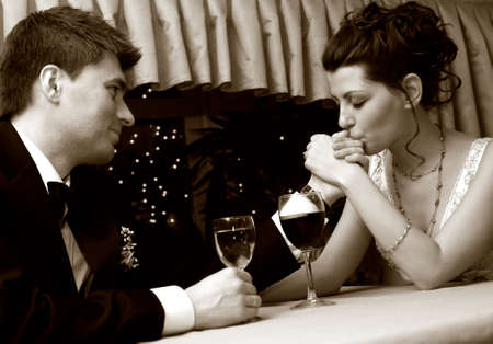 Recently married pair at restaurant in celebrating on romantic date. b/w+sepia Stock Photo - 3662509