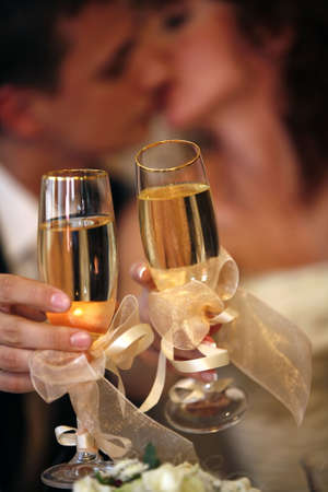 Glass of champagne in a hand of the groom and bride Stock Photo - 3670030