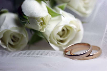 Wedding rings on a background of white flowers Stock Photo - 3670033
