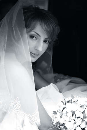 Beautiful the bride with a bouquet in the automobile Stock Photo - 3685565