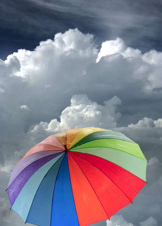 Rainbow umbrella against blue sky photo