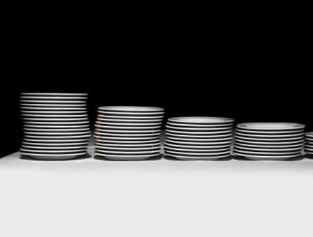 Pile of white plates on a black background Stock Photo - 3898347