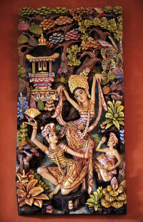 mastery: Wooden pattern-manual with the image dancing girls. Bali. Indonesia Stock Photo