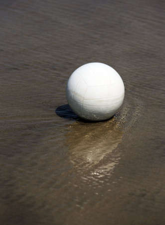 White ball rests in transparent water photo