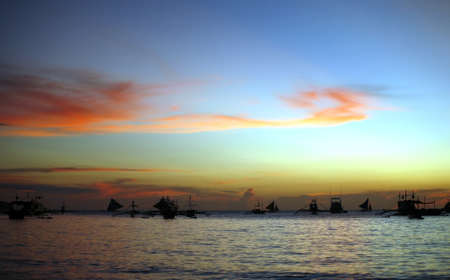 Drifting boat on a sunset on the tropical island. Philippines Stock Photo - 3952259