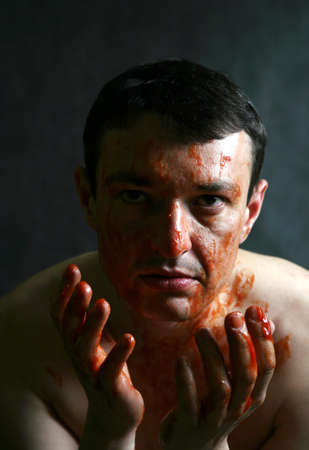 denying: The man soiled with a red paint