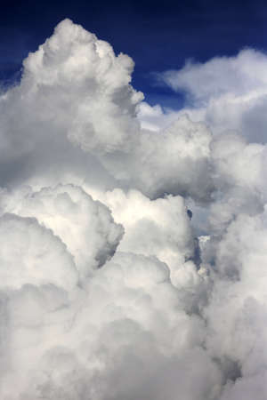 soft hail: The image of white clouds on a background of the dark blue sky