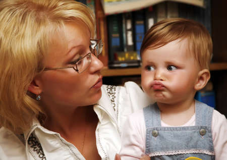 Portrait of the little girl with mum at home photo