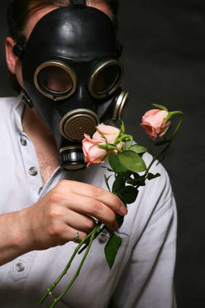 fetishes: The man in a gas mask with flowers